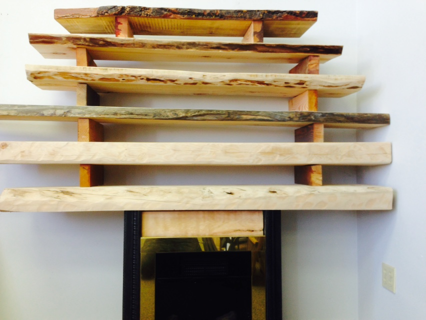Multiple Fireplace Mantels Stacked Together